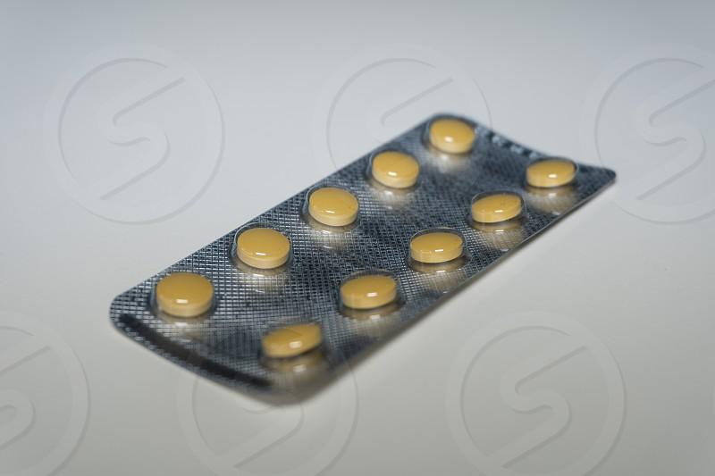 Pills on white background photo