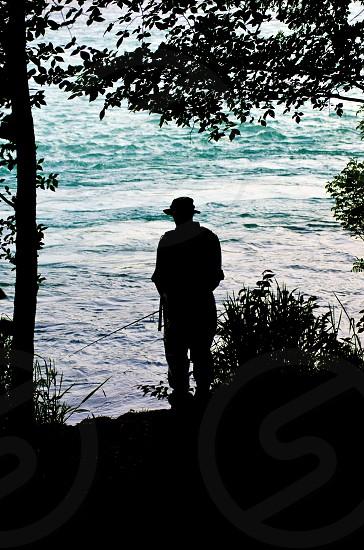 man fishing on river photography  photo