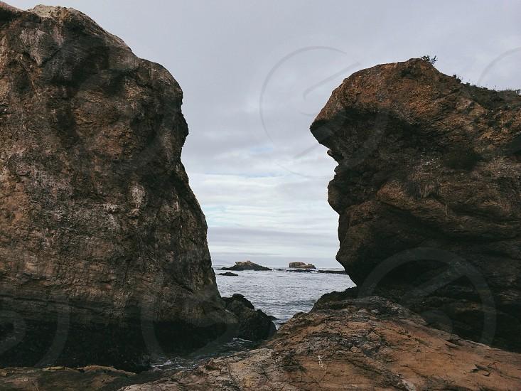 Brown rocks on teh sea photo