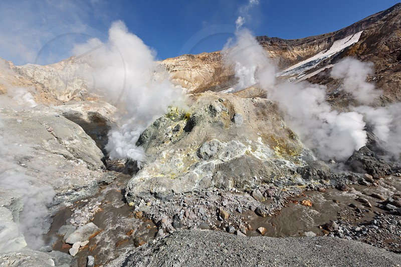 Volcanic landscape of Kamchatka: hot spring and fumarole field gas-steam activity in crater of active Mutnovsky Volcano. Eurasia Russian Far East Kamchatka Peninsula. photo