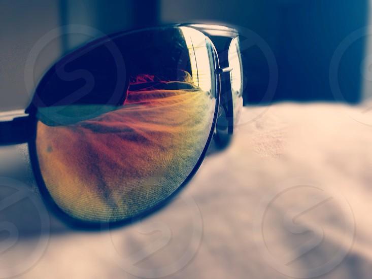 black framed sunglasses macro shot photo