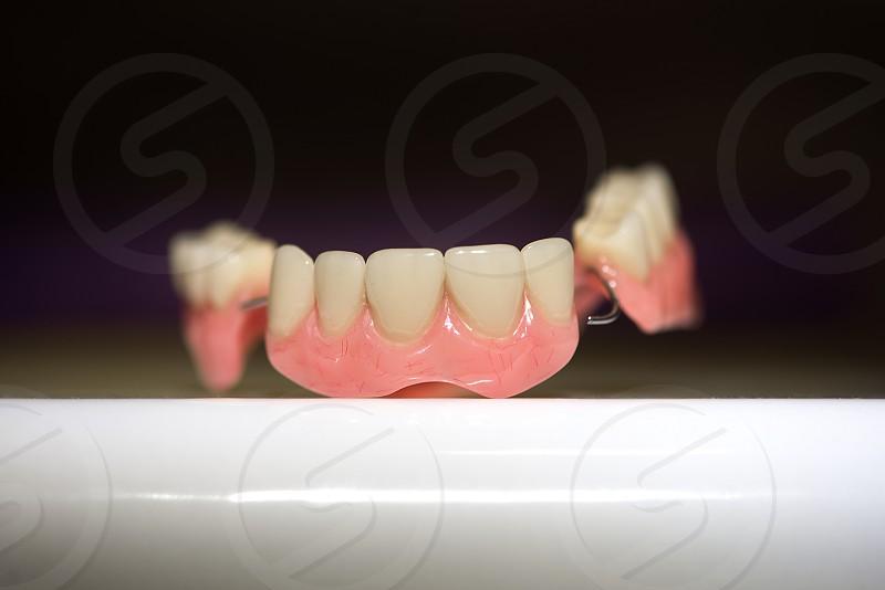 Dental prosthesis on dark background photo