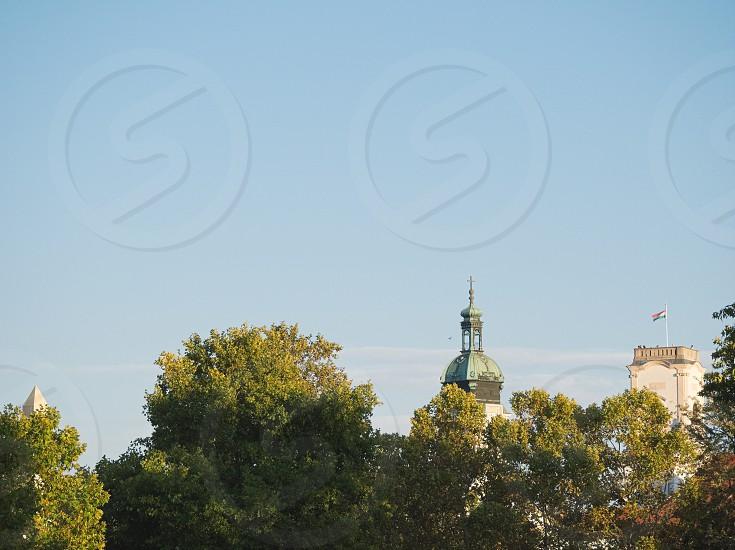 Landmarks of Győr City Rising above Treetops on a Sunny Autumn Day photo