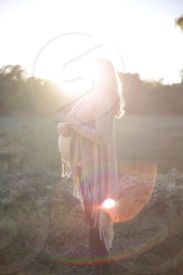 woman in long fringe hem shawl in field photo