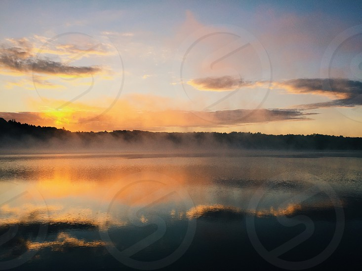 Lake water sunrise mist fog morning photo