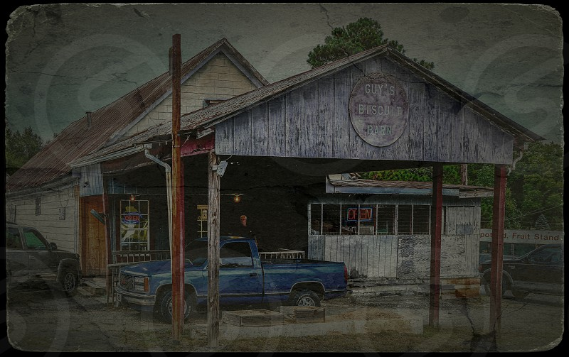 Breakfast is one of my three favorite meals and a stop at Guys Biscuit Barn in Cumming Georgia did not disappoint. I was struck with the rustic look of the exterior and thought it looked good as an old postcard. photo