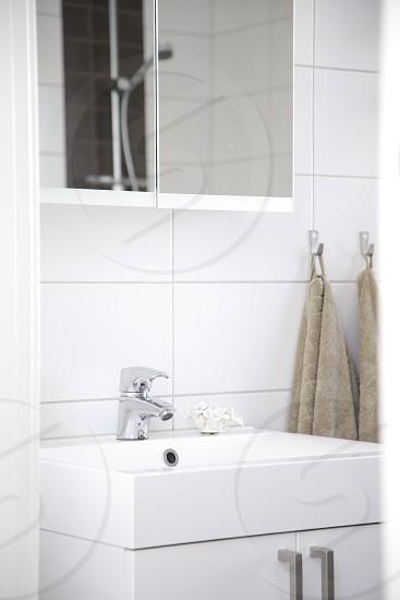 Modern white clean and fresh bathroom details photo