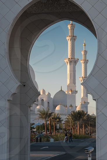 View of the stunning mosque in Abu Dhabi through the arched entrance photo