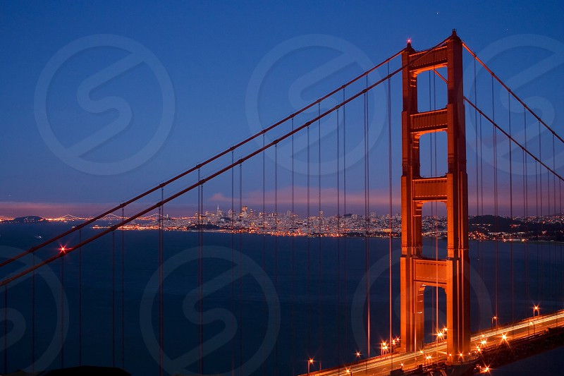 lighted golden state bridge during golden hour photo