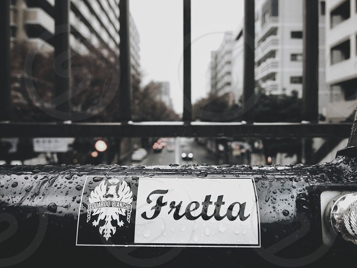 fretta sign under railing photo