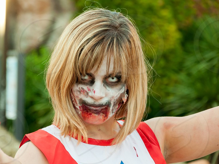 woman putting zombie makeup photo
