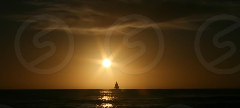 Sunset Sailing Wispy Clouds photo