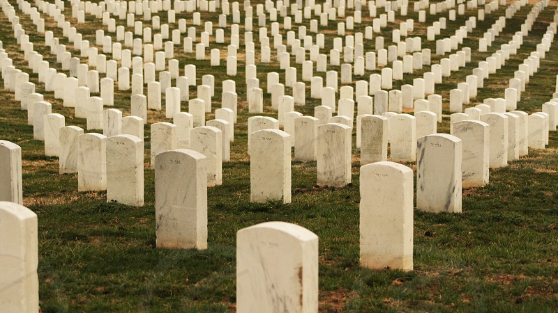 white concrete grave plates on cemetery photo