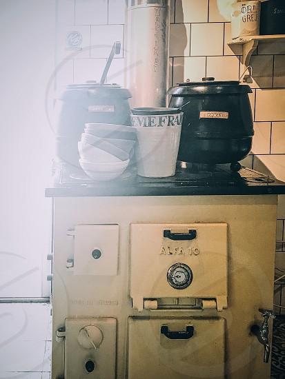 Bohemian style interior kitchen  food stove vintage pots casserole  photo