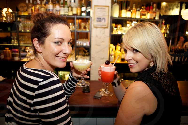 Two females having cocktails during cocktail hour photo