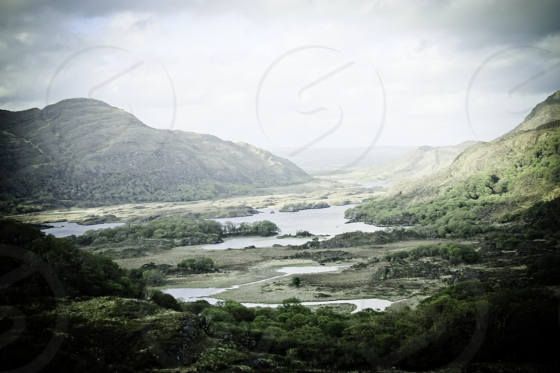 Landscape photograph of sea and mountains in Ireland's Ring of Kerry. photo
