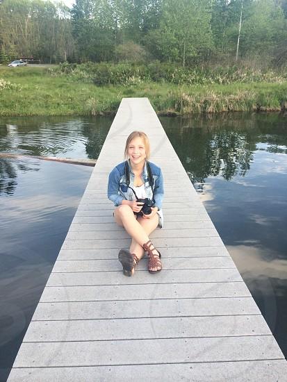 woman sitting on harbor photo
