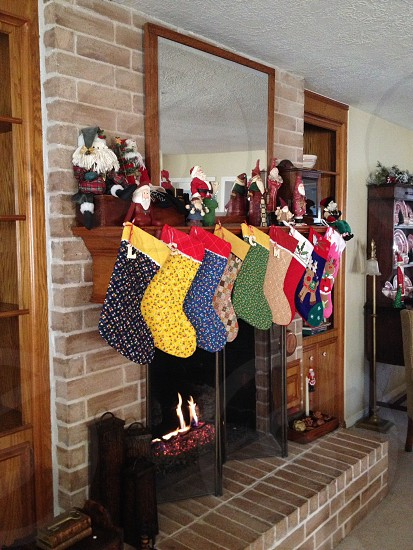 red blue yellow and green socks in the fire place photo