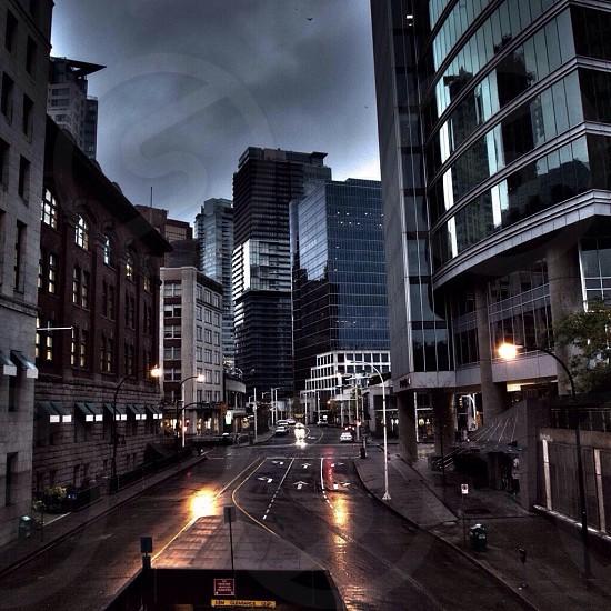 gray road between buildings photo