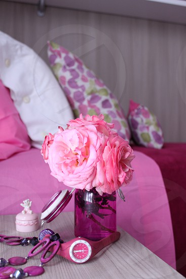 pink flower near pink items photo