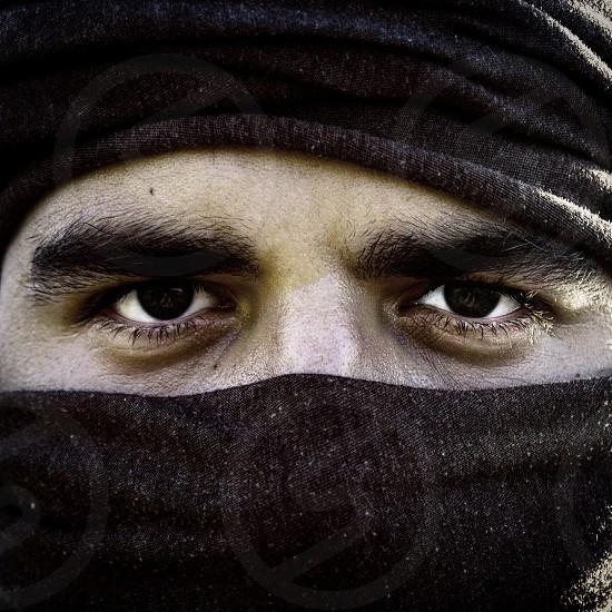 man wearing black mask photo
