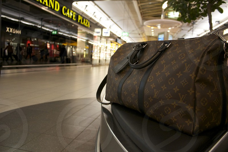 This is Amsterdam Airport. Bag ready for the travel. photo