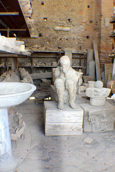 The City Of Pompeii artifacts allow us to see the exact position the person was in when he or she died.  This picture was taken during my trip to Italy.  Truly a meditation pose. photo