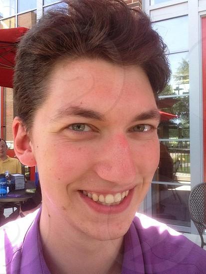 man wearing purple collar-neckline shirt photo