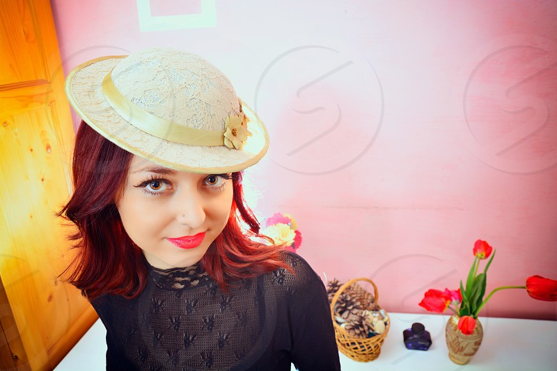 Red hair female wearing a white hat and balck sheer top photo