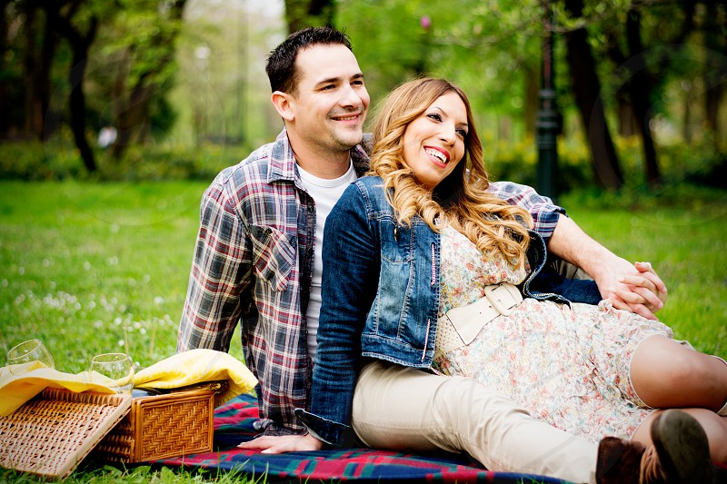 Happy young couple in park on picnic photo