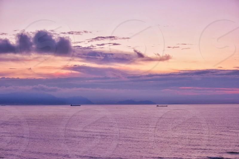 Sunset peace relax wellness coast ocean sea beach beautiful ships photo