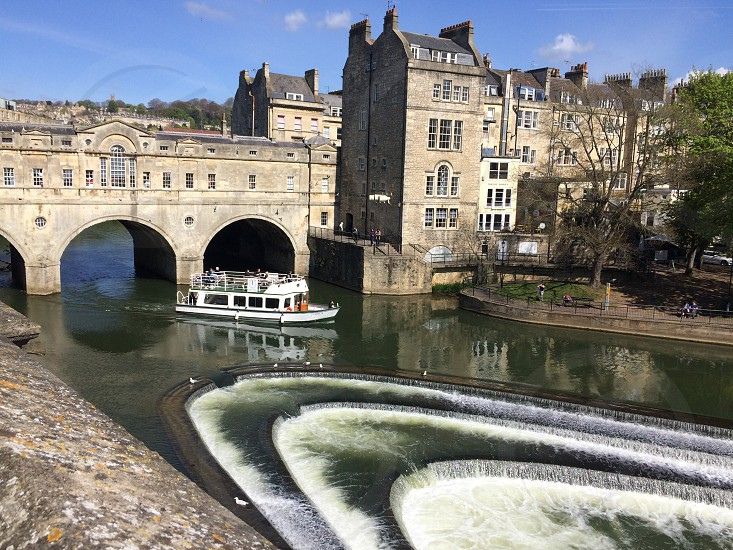 Bath England weir water boat historic buildings photo