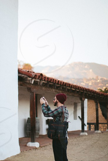 man taking a photo using a smartphone photo