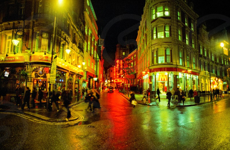 London wet streets neon signs night streetlights film photo