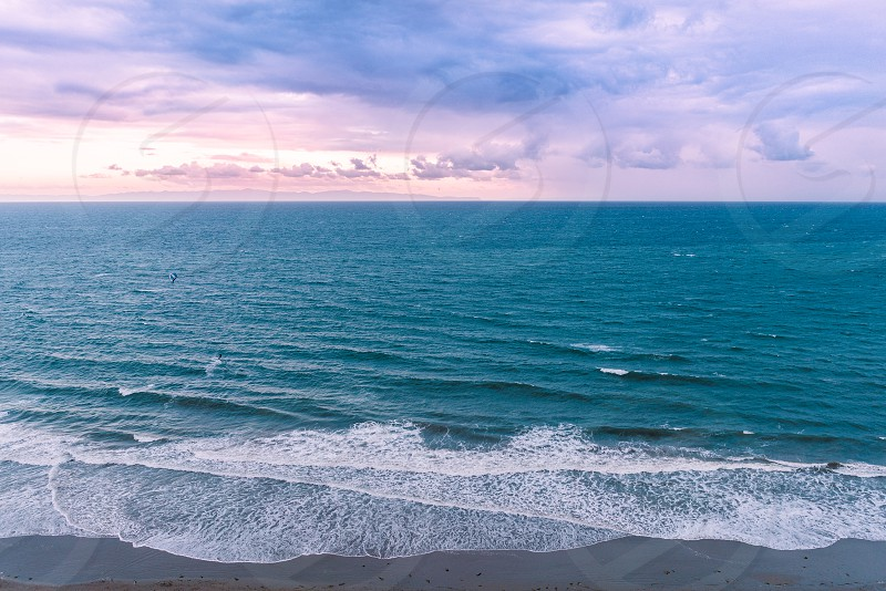 sea ocean blue purple coast beach waves california clouds horizon photo