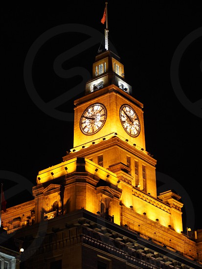 The Clock Tower atop one of the many colonial buildings owned by the British Concession Holders along The Bund.    photo