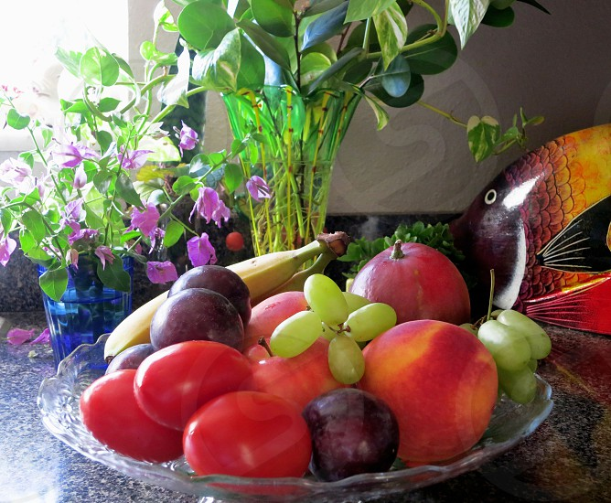 Fruit and flowers on kitchen counter photo