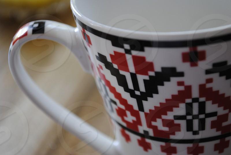 white black and red ceramic mug photo