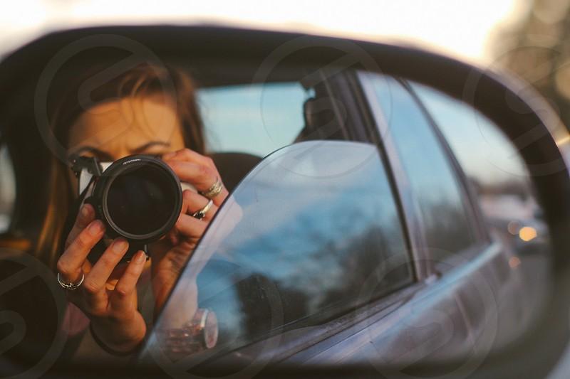 Car driving camera photo mirror side-view mirror bright beautiful vivid window rings nails girl hair brown hair photo