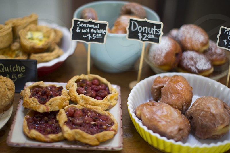 seasonal fruit galette donuts and quiche on display photo