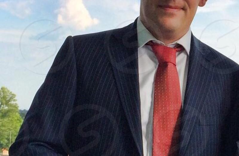 Finance planning business blue pin stripe suit red polka dot silk tie photo