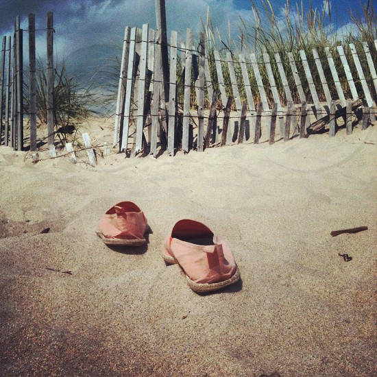 pink slip on shoes on sand photo