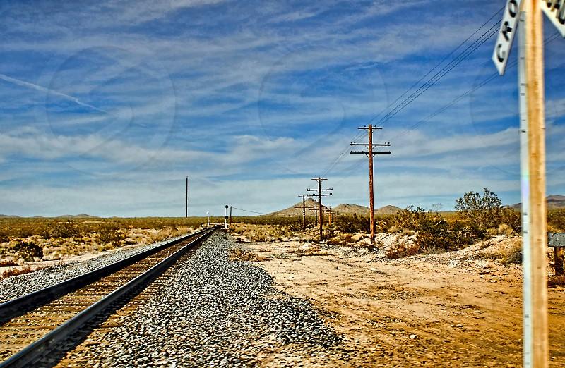 Freight Train tracks across the desert photo