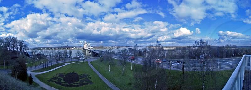 Skyline Clouds blue green road firecar  photo