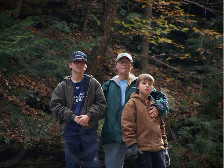 man with 2 boys on forest photo