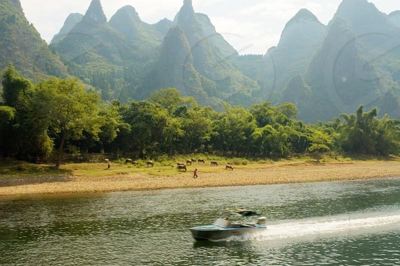 Speedboat on the Li River China photo