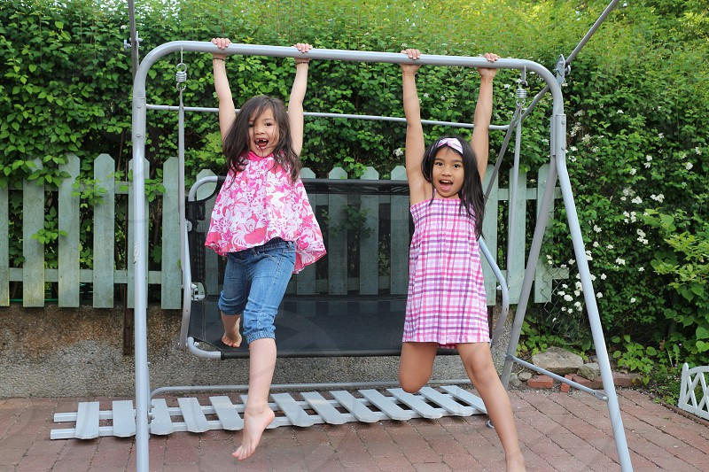 LisAm nieces children playing fun happy swing enjoy sisters photo