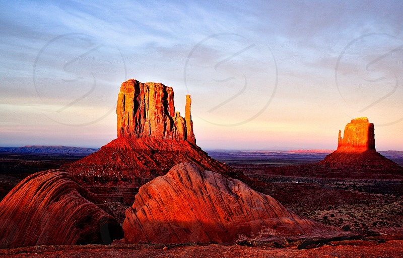 Sunset in Monument Valley Arizona over red rock mountain formations photo