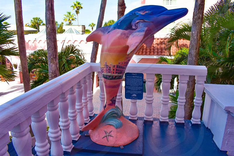 St. Pete Beach Florida. January 25 2019. Colorful Dolphin statue on balcony of The Don Cesar Hotel. The Legendary Pink Palace of St. Pete Beach (1) photo