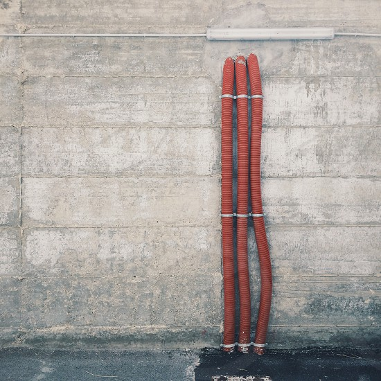 Concrete pipes tubes red gray urban city photo
